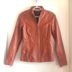 Danier genuine leather rust coloured fitted jacket